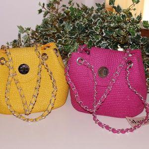 pink handbag and yellow handbag